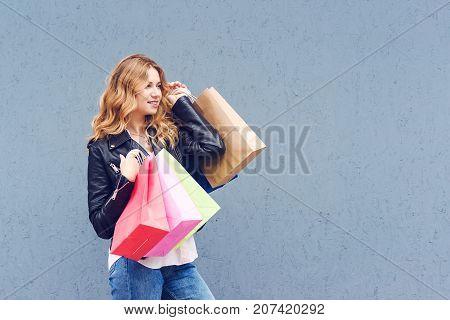 Portrait Of Joyfull Woman Holding Shopping Bags.