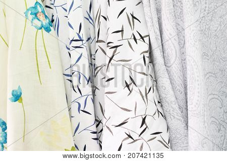Colors and pattern of fabric in fabric store. Type of fabric.