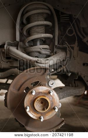 Close up shot of old brakes and shock absorbers.