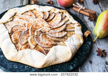Pie With Apples, Pears And Cinnamon On An Old Wooden Background