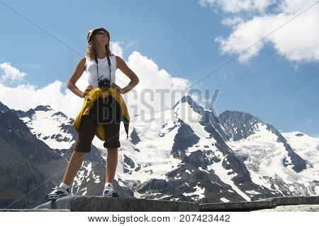 Woman Tourist hiking Mountain, young girl outdoor portrait,  looking up over Mountains peaks landscape