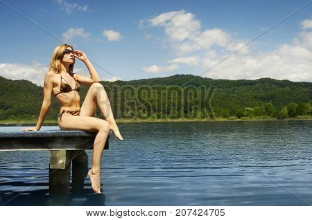 Sexy Woman in Bikini Resting on Lake, Summer Vacation Outdoor Holiday, Young Girl Posing over Mountain Landscape