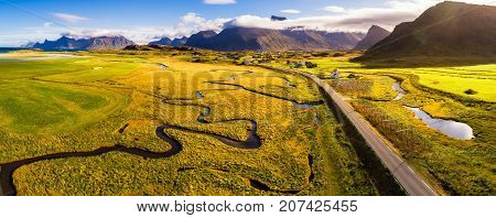 Aerial view of a scenic road through villages and mountains on Lofoten islands in Norway