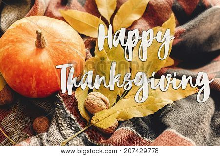 Happy Thanksgiving Text Sign On Autumn Pumpkin With Colorful Leaves  And Walnuts On Stylish Scarf Fa