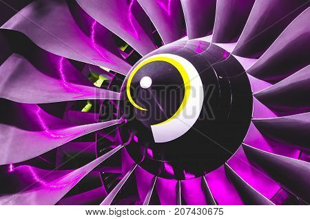 Airplane Engine And Blades With Purple Backlight Illumination Close Up.