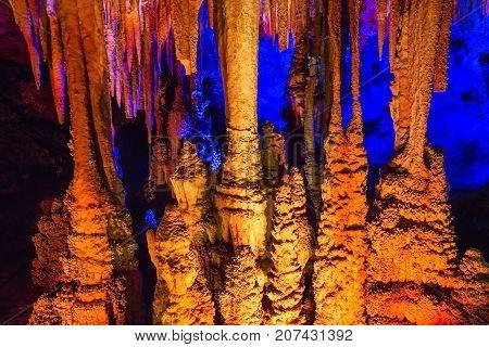 Venetsa cave in Bulgaria with onyx stones. Illuminated flowstones, stalactites and stalagmites