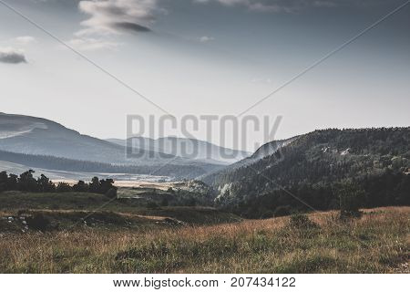 Majestic view of mountain valley. Dramatic and picturesque morning scene. Retro vintage color style, toned