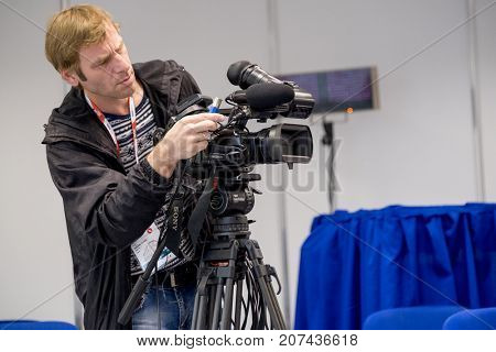 Moscow, Russia - August 31, 2017: Operator preparing tv camera to the live broadcast