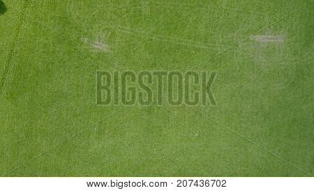 Aerial photo over grass field with tyre tracks