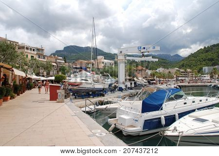 MAJORCA, SPAIN - SEPTEMBER 6, 2017: Boats moored along the quay at Port de Soller on the Spanish island of Majorca. The West coast town is a popular tourist destination.