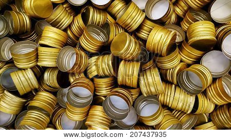 Pile of bottle metal screw caps as pattern background large group of shiny objects as texture
