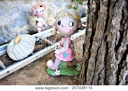 The old doll in the abandoned yard. Fear, horror, Helloween.
