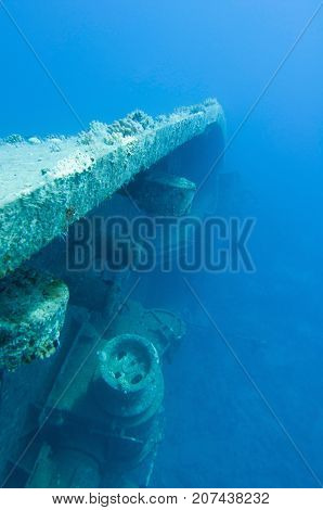 Shipwreck On Her Side, Underwater Photo, Blue Backgrond