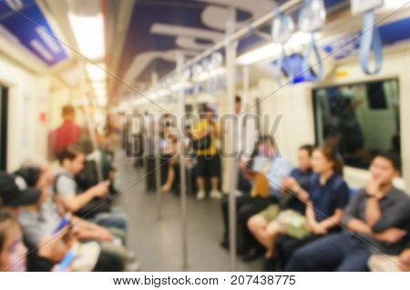 blurred image of people inside subway at train station transport in rush hour people lifestyle transportation concept