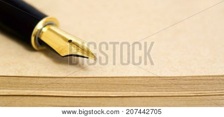 Web banner of old fountain pen on paper sheets with copy space