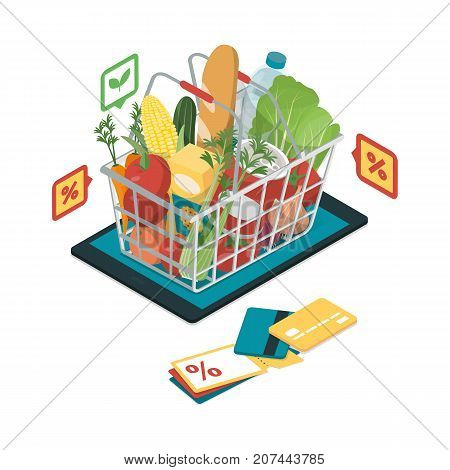 Fresh vegetables and grocery products with icons in a shopping basket on a digital tablet grocery shopping online and augmented reality concept