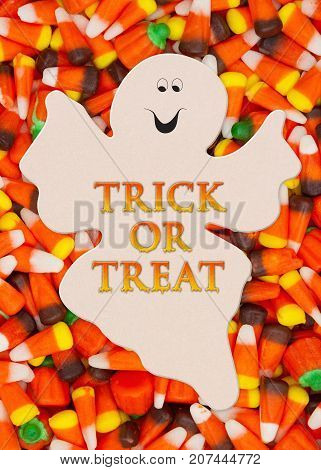 Trick or Treat Greeting with candy corn on a spooky ghost
