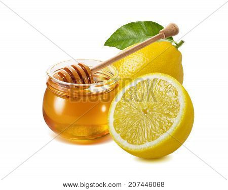 Traditional remedy for flu and cold treatment - honey jar plus lemon isolated on white background