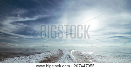Motor boat water traces in open caribbean sea. Travel destination