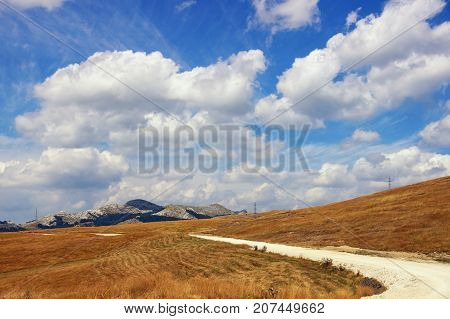Landscape with a mountain country road. Balkans. Montenegro, Krnovo (near Niksic town)
