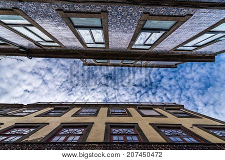 Residential buildings with tiled facades on Rua do Pinheiro in Porto Portugal