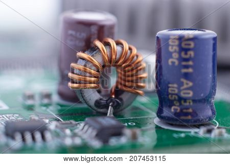 inductor with motherboard background. Computer board chip circuit. Microelectronics hardware concept. electronic device.