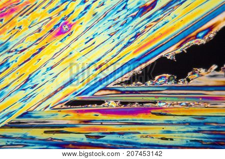 microscopic shot of urea micro crystals in polarized light