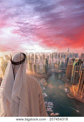 Arabian Man Is Watching Dubai Marina In Dubai, United Arab Emirates.