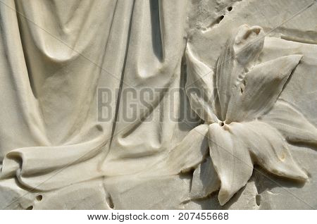 THUNDERBOLT, GA - September 16,, 2012 Carved lily and drape on a tombstone at Bonaventure Cemetery.
