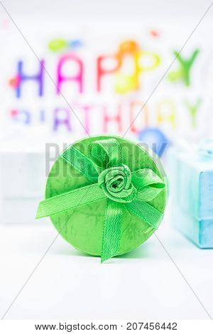 Happy Birthday. Green gift box on a festive background. Free space for text