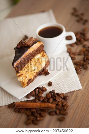 piece wof sweet brownie with chocolate and coffee