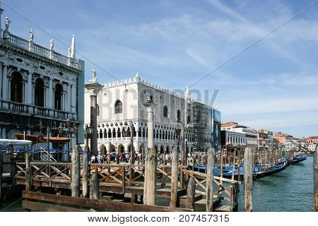 Venice, Italy - June 21, 2010: Views of the most beautiful canal of Venice - Grand Canal water streets boats gondolas mansions along. Italy.