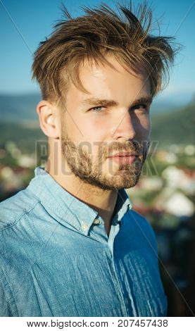 Man With Bearded Face And Haircut Posing In Blue Shirt