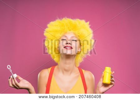 girl in clown costume smiling looking up