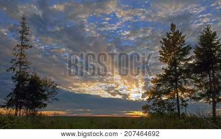Beautiful Sky With Clouds At Sunset And The Rays Of The Sun