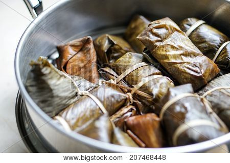 thai traditional steamed banana sticky rice dessert