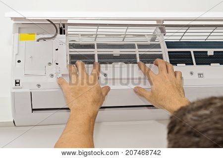 Man Changing the Filter in the Air Conditioning The Concept of Safe and Healthy Housing