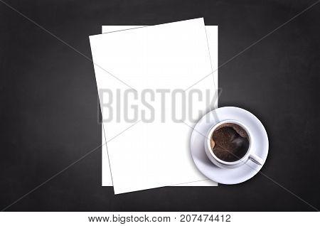 Blank letterhead and coffee cup on black table background. Blank branding template. Mockup for branding identity for placing your design. Top view.