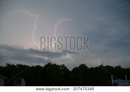 storm clouds lighting up the sky with lightning  during severe storms