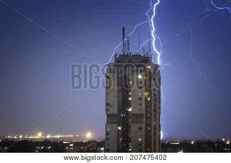 Thunderstorm over night city. Weather forecast concept.