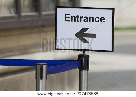 Entrance sign with direction arrow at exhibition or museumm horizontal