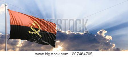 Angola waving flag on blue sky. 3d illustration