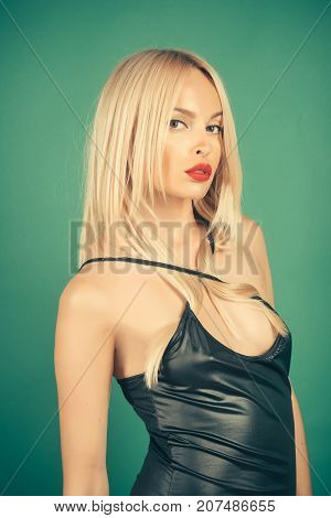 Girl With Long Blond Hair On Green Background