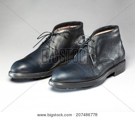 Fashionable shoes for cold weather on a gray background