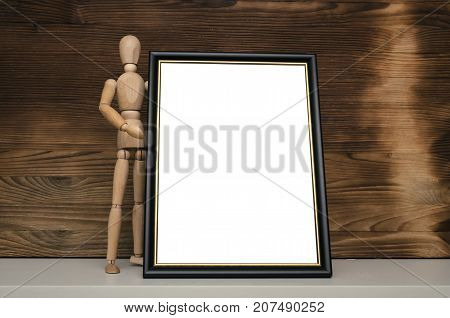 Grateful letter. Gratitude concept. Accolade. Thank letter. Special offer. Wooden doll holding empty blank photo frame. Appreciation document.