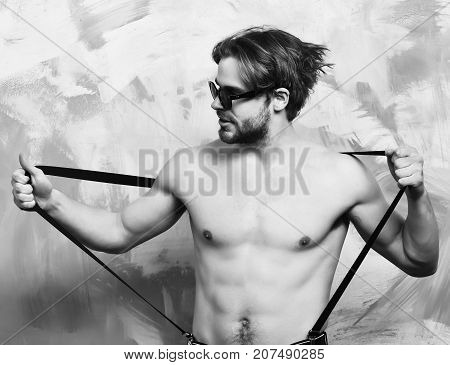 Caucasian Bearded Sexy Macho Man In Pants With Suspenders