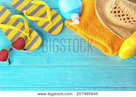 Composition with summer accessories on wooden background