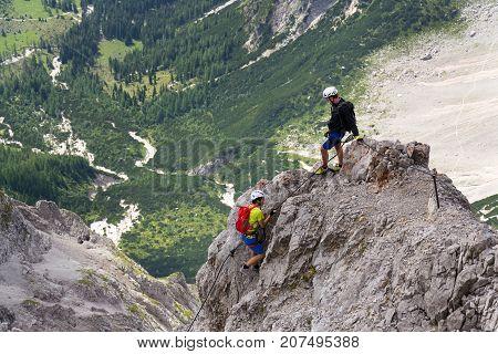 Ramsau Am Dachstein, Austria - August 17: People Climbing On Via Ferrata To Dachstein Glacier On Aug
