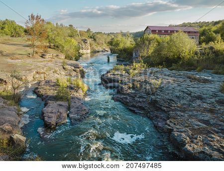 day in the afternoon flowing river Gorny Tikich among stones and a canyon in the village of Buki Ukraine