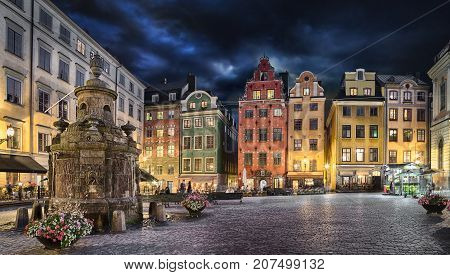 Stortorget square with colorful couses in the center of Old Town (Gamla Stan) of Stockholm Sweden at dusk